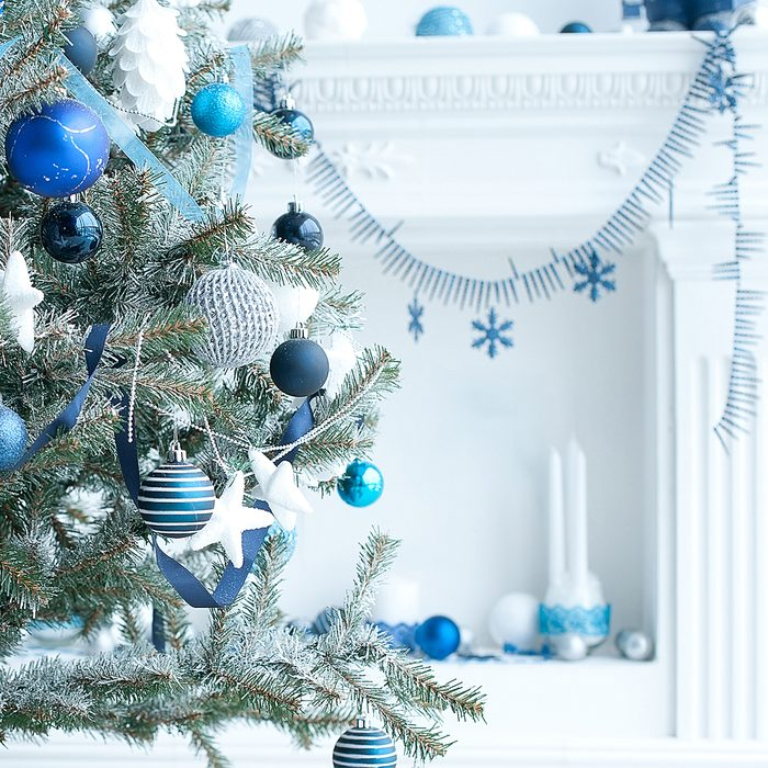 Christmas tree with blue and white toys in the interior