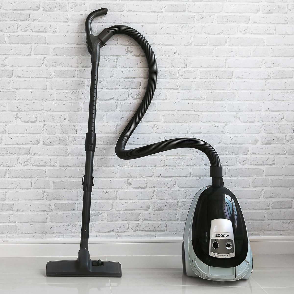 Vacuum cleaner against concrete wall