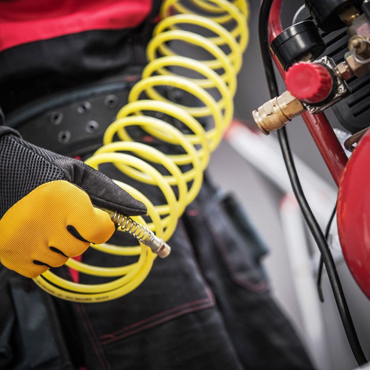 Air Compressor in a Hand. Professional Auto Service Equipment.