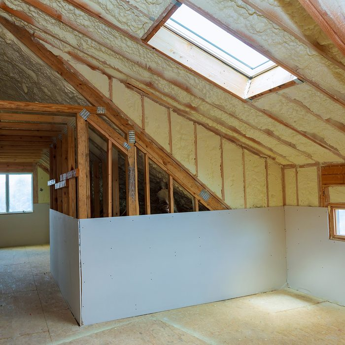 termal insulation installing at the attic insulation of the house