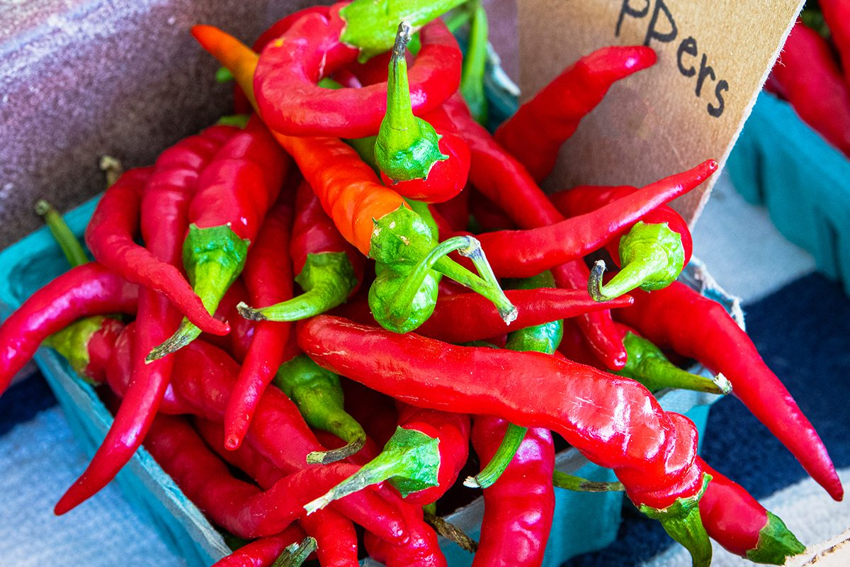 Basket of HOT CAYENNE PEPPERS photographed close up on a farm stand in central Pennsylvania. Produce, Food, Onions, Farm, Vegetable fresh on country farm stand. Good background image