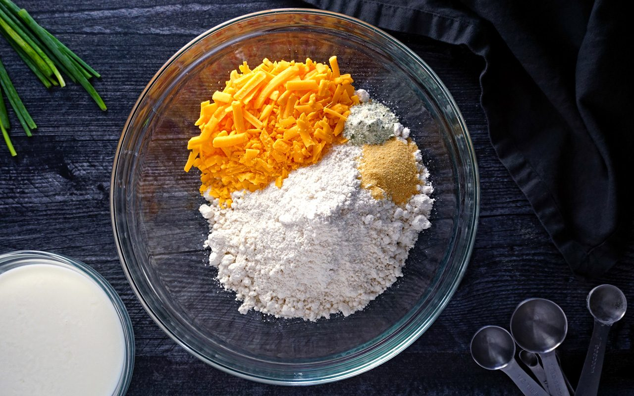 adding biscuit ingredients to a bowl red lobster cheddar bay biscuits