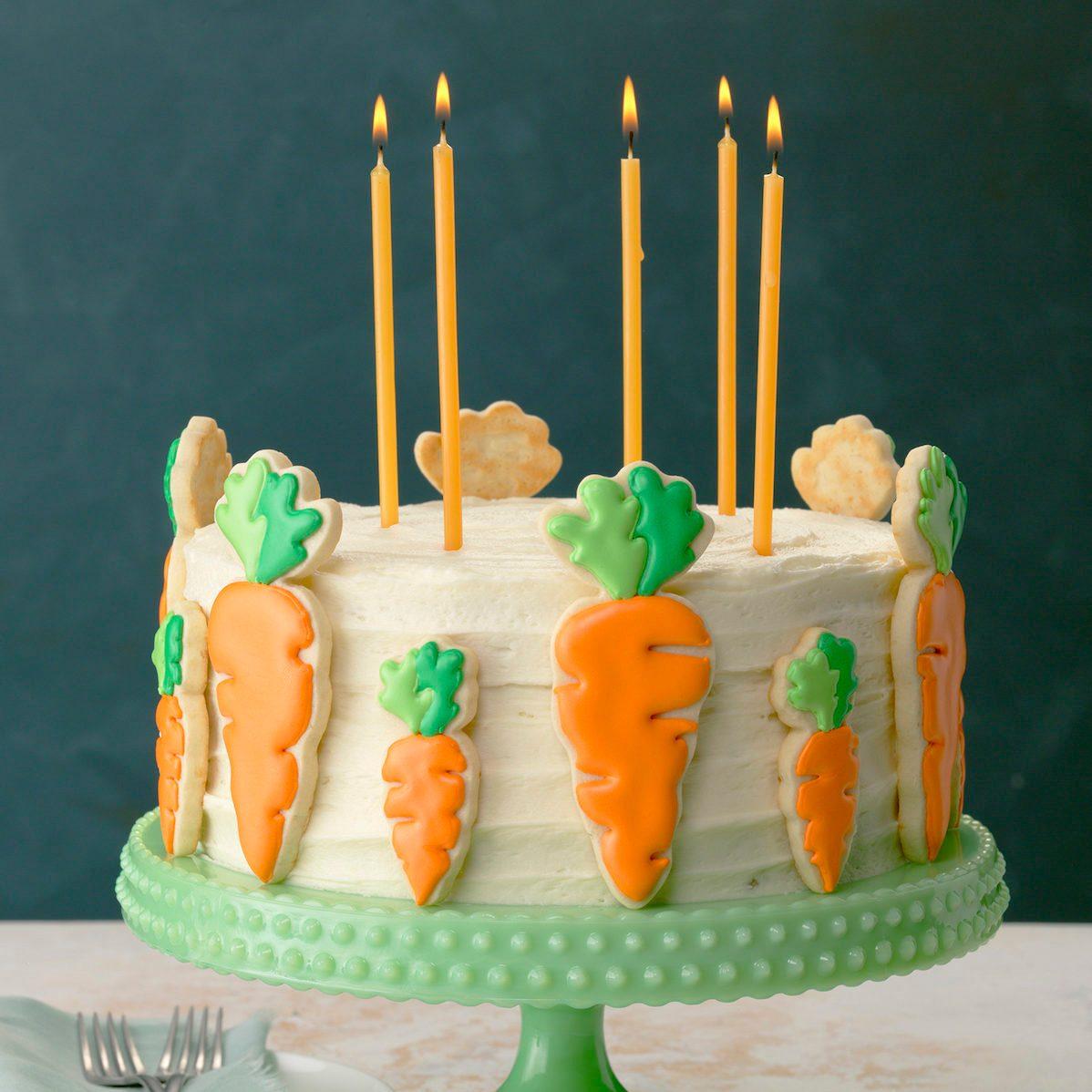 green pedistal; aqua linen; green wall; forks; light painted surface; candles