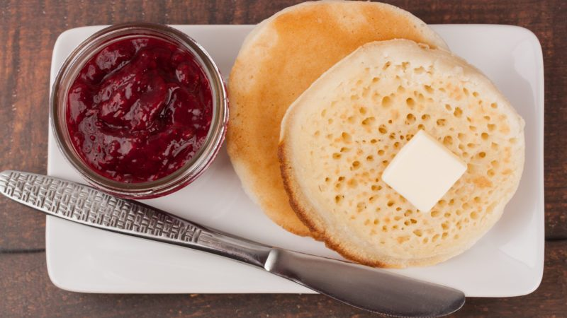 Delicious crumpets and raspberry jam in a reusable glass jar; Shutterstock ID 1552194548; Job (TFH, TOH, RD, BNB, CWM, CM): TOH Crumpets