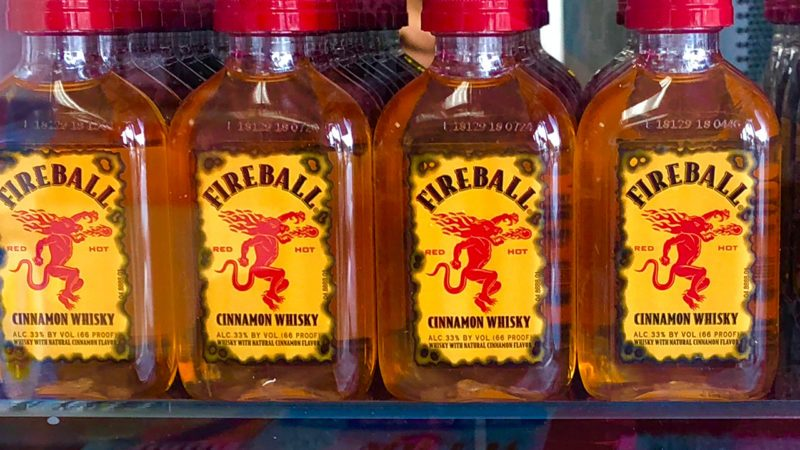 Fireball Cinnamon Whisky is a mixture of whisky, cinnamon flavoring and sweeteners that is produced by the Sazerac Company.