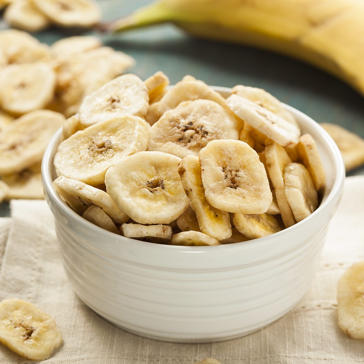 Homemade Dehydrated Banana Chips in a Bowl