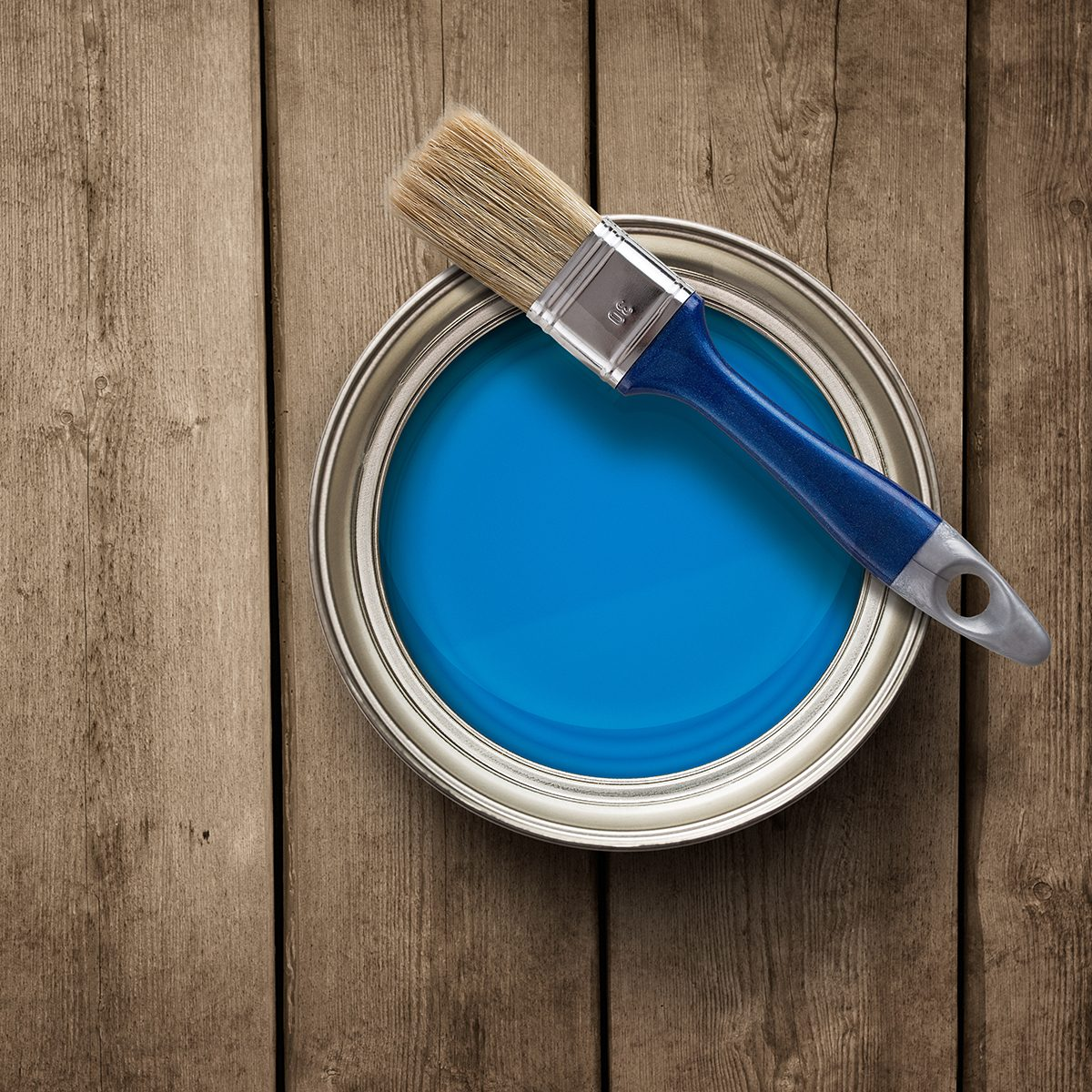 House renovation, paint can on the old wooden background