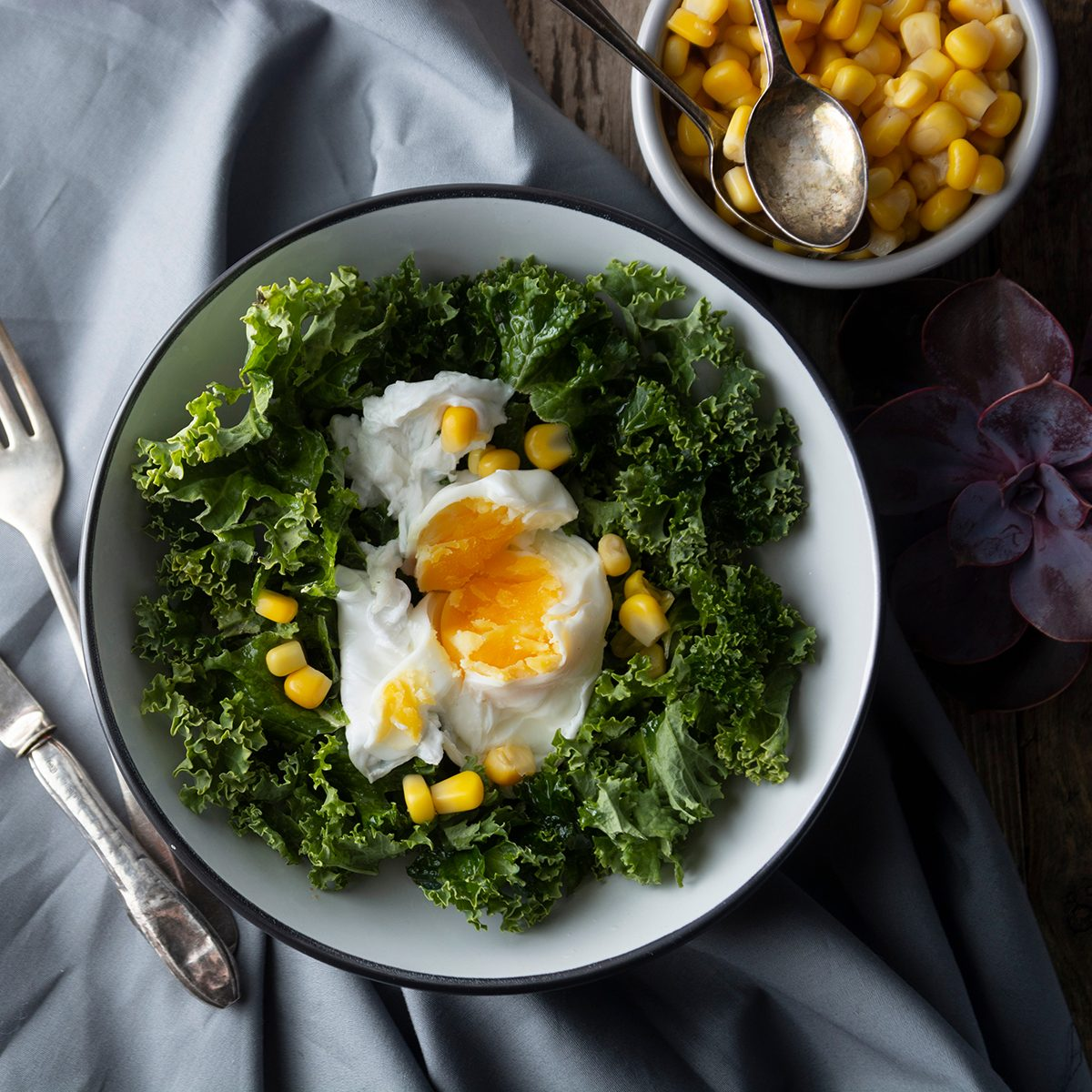 Poached eggs with Kale lettuce, salad. Healthy breakfast or dinner.