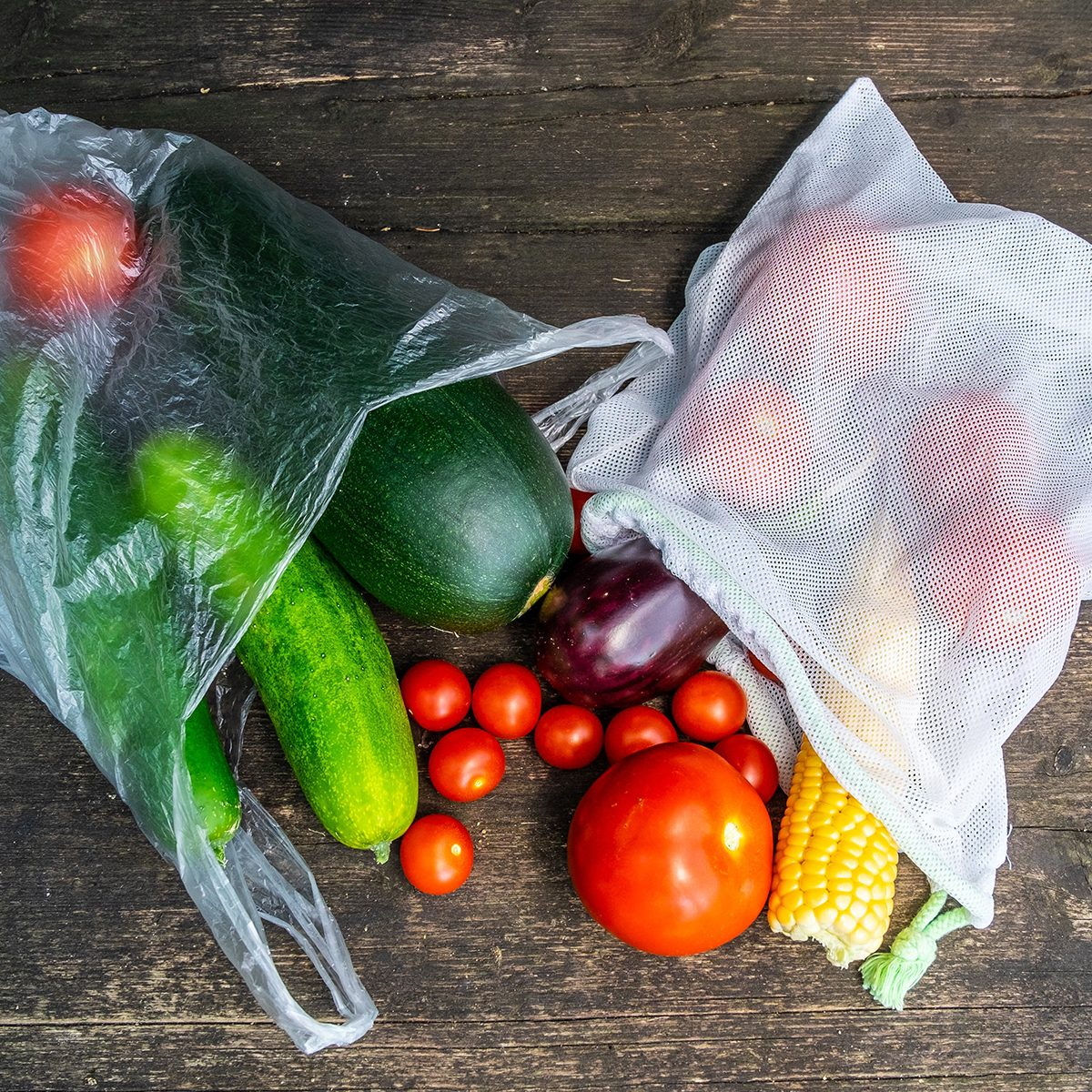 Plastic bags filled with produce