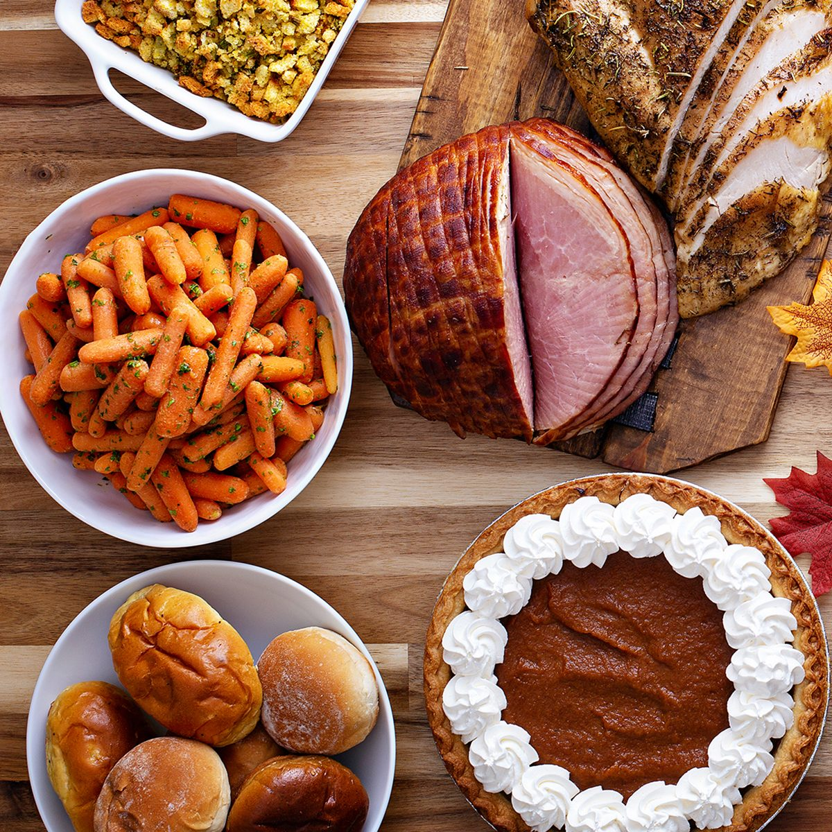 Thanksgiving table with roasted turkey, sliced ham and side dishes; Shutterstock ID 1178474017; Job (TFH, TOH, RD, BNB, CWM, CM): TOH