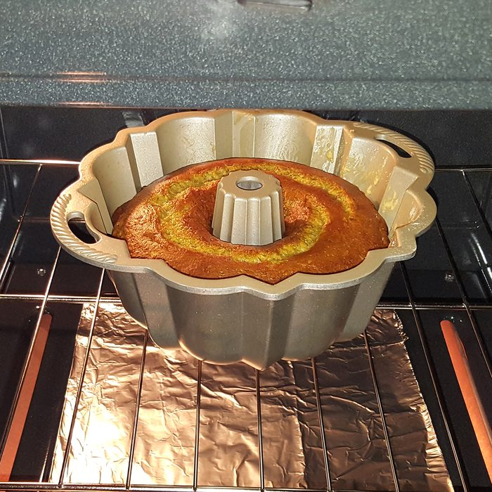 Golden Bunt Cake in Oven ; Shutterstock ID 1191256759; Job (TFH, TOH, RD, BNB, CWM, CM): TOH