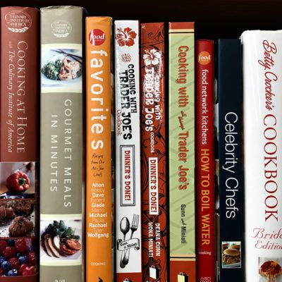 """Minneapolis, MN/USA. January 5th, 2019. Cookbooks on display on a shelf in Minneapolis including """"Cooking at Trader Joe's"""" and """" Gourmet Meals in Minutes.""""; Shutterstock ID 1275539782"""
