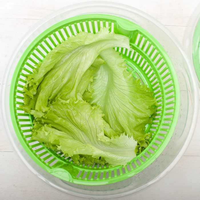 Close up of salad spinner with lettuce on white table; Shutterstock ID 229211386; Job (TFH, TOH, RD, BNB, CWM, CM): TOH