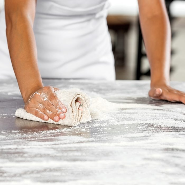 Midsection Of Baker Cleaning Flour From Table; Shutterstock ID 427301953; Job (TFH, TOH, RD, BNB, CWM, CM): Taste of Home