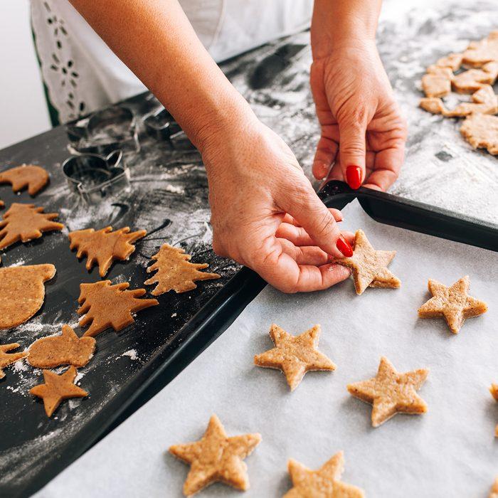 Woman preparing Christmas cookies at home; Shutterstock ID 523267942; Job (TFH, TOH, RD, BNB, CWM, CM): Taste of Home