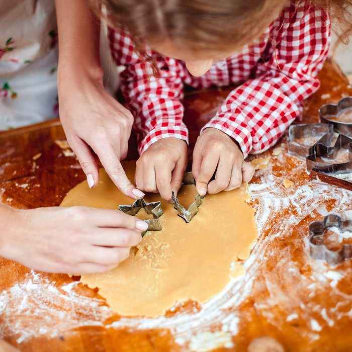 Merry Christmas and Happy Holidays. Family preparation holiday food. Mother and daughter cooking cookies in New Year interior with Christmas tree.; Shutterstock ID 730827214; Job (TFH, TOH, RD, BNB, CWM, CM): Taste of Home