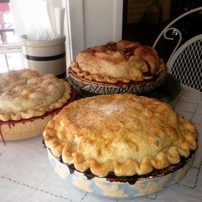 Fruit pies on a counter together