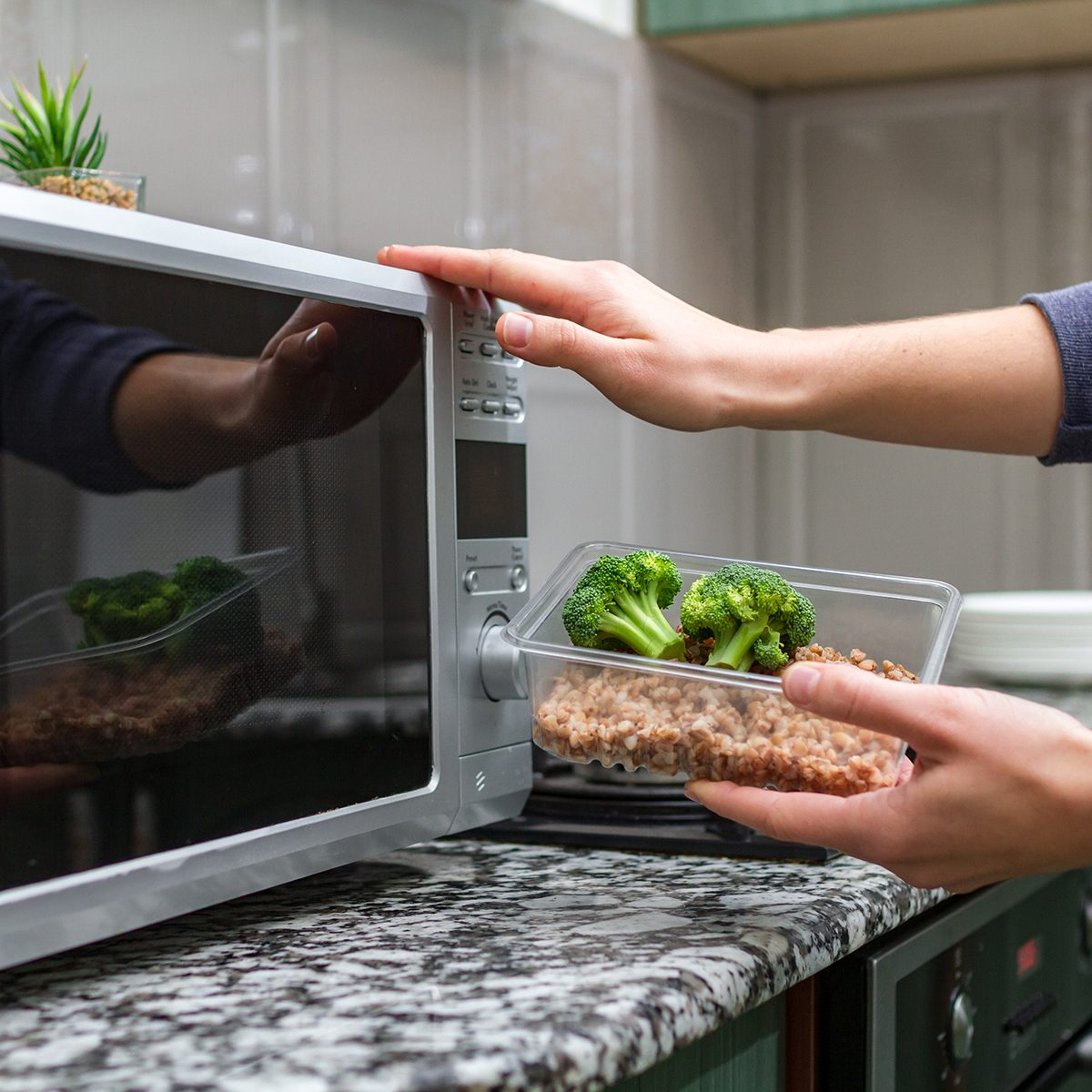 Using the microwave oven to heating food.