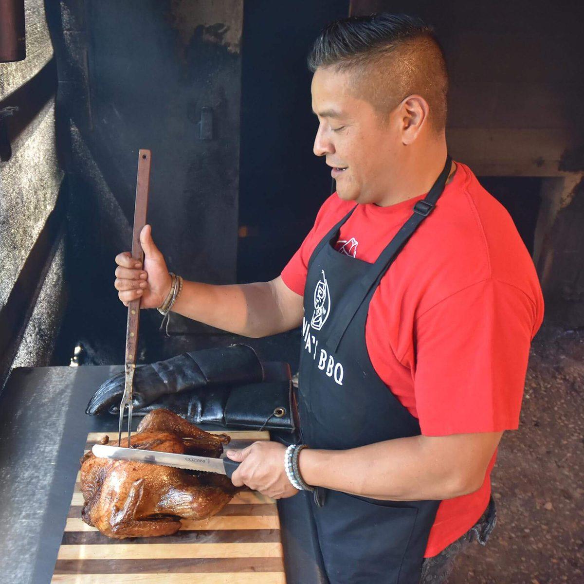 CHEF ADRIAN DAVILA slicing a turkey