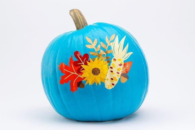 Blue painted pumpkin with vinyl appliques