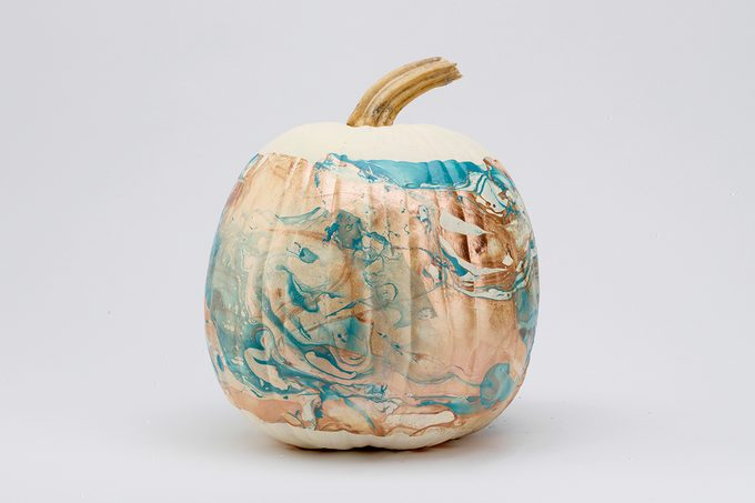 White pumpkin painted with marble swirl color design