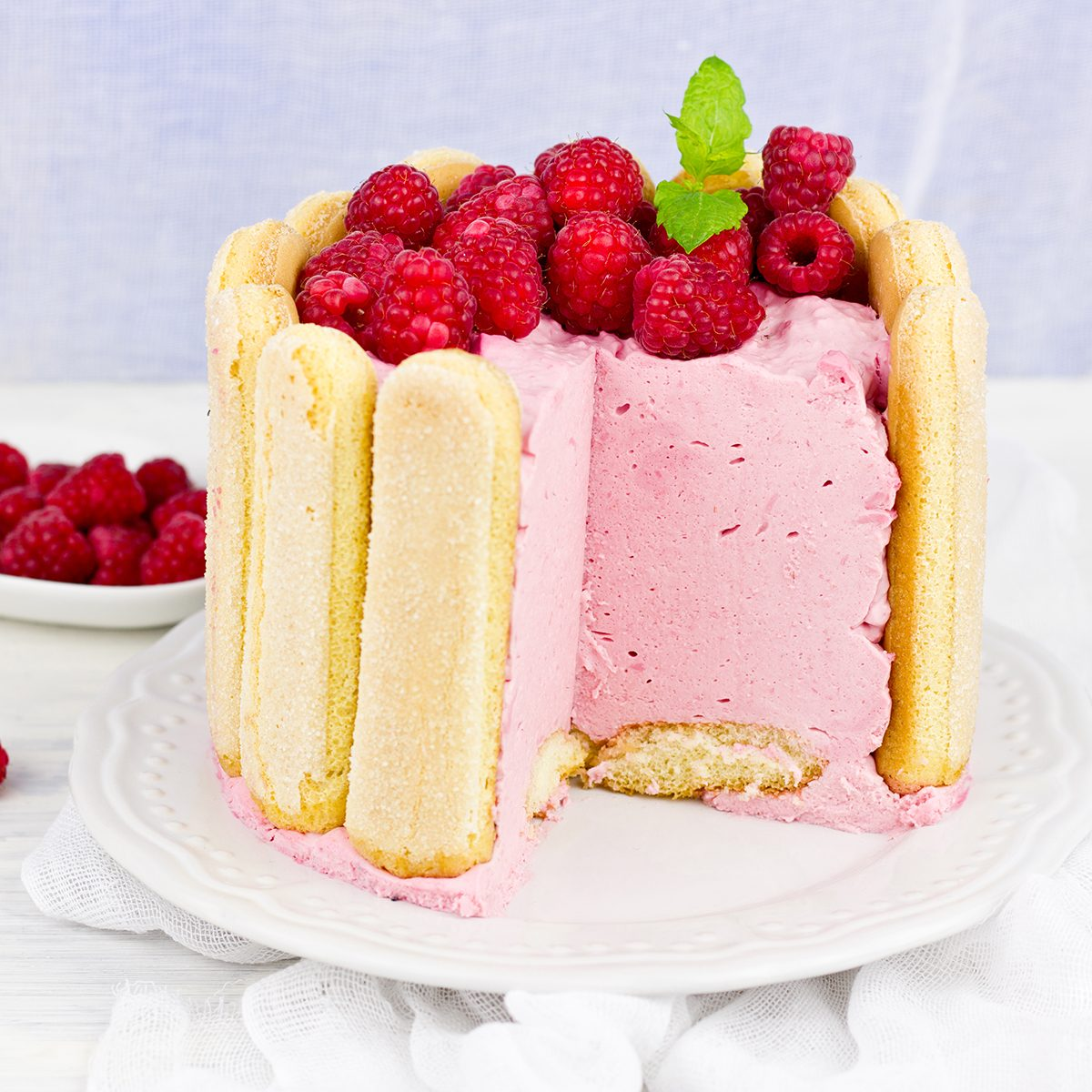 """Cake """"Charlotte Russ"""" with raspberries and cream, selective focus."""