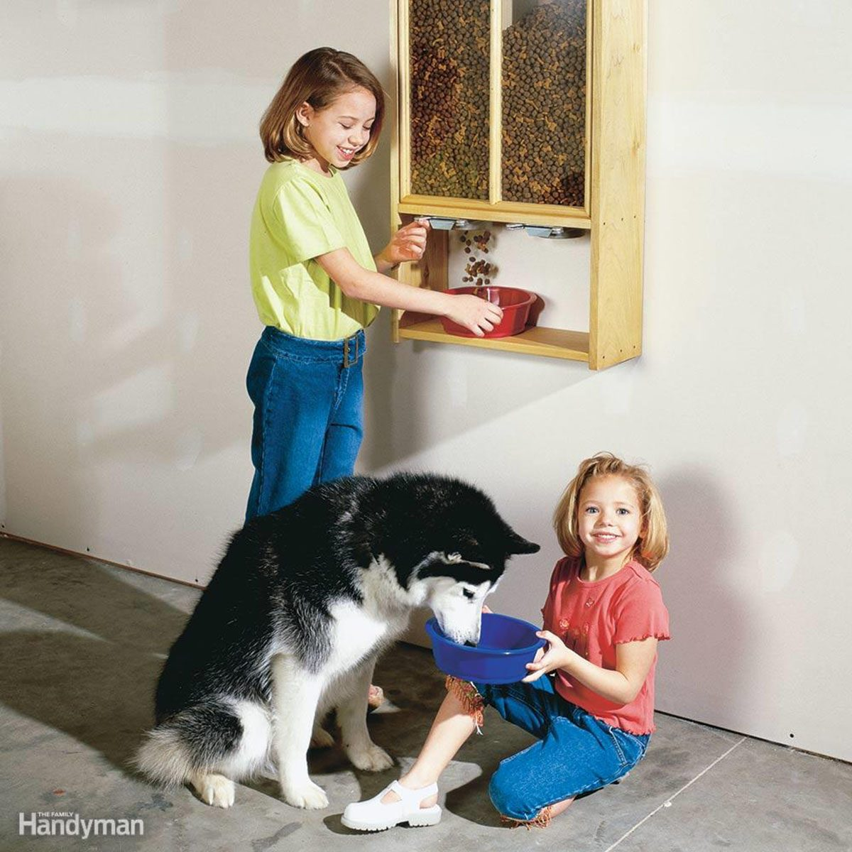 Two kids feeding husky