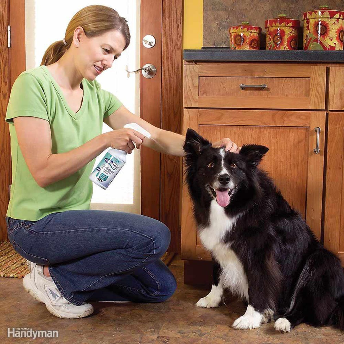 Smiling woman using a spray bottle on a dog