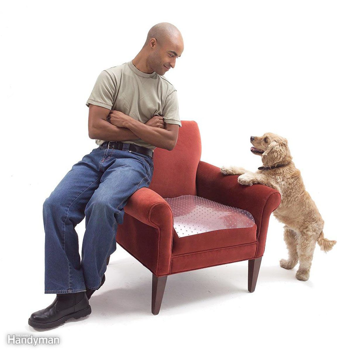 Man and dog sitting on the arms of a chair