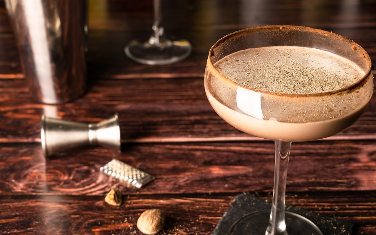 Alexander cocktail in a cocktail glass, served with cocoa on the rim