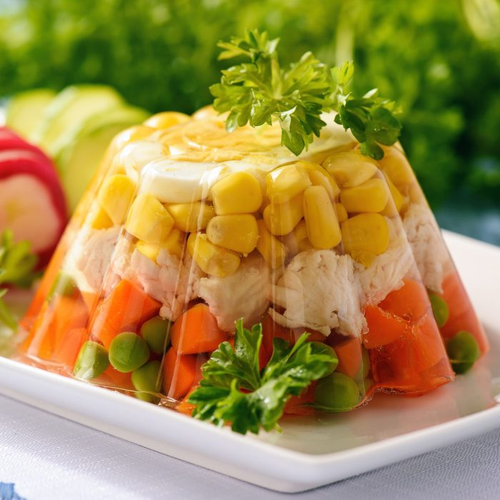 Aspic- jellied chicken with egg and vegetables.