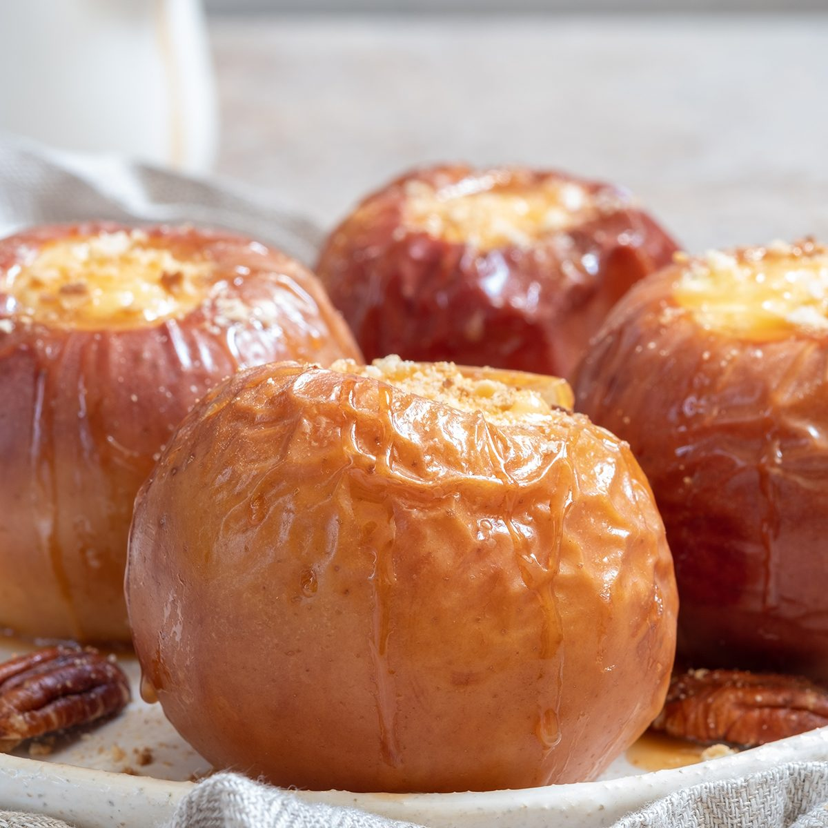Baked apples stuffed with cheesecake and caramel; Shutterstock ID 1192631479; Job (TFH, TOH, RD, BNB, CWM, CM): TOH