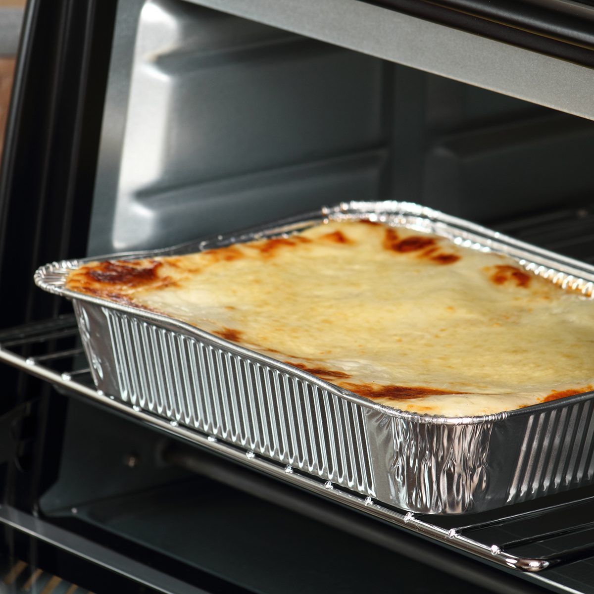 Baking Lasagne Bolognese in Disposable Foil Dish in Electric Oven