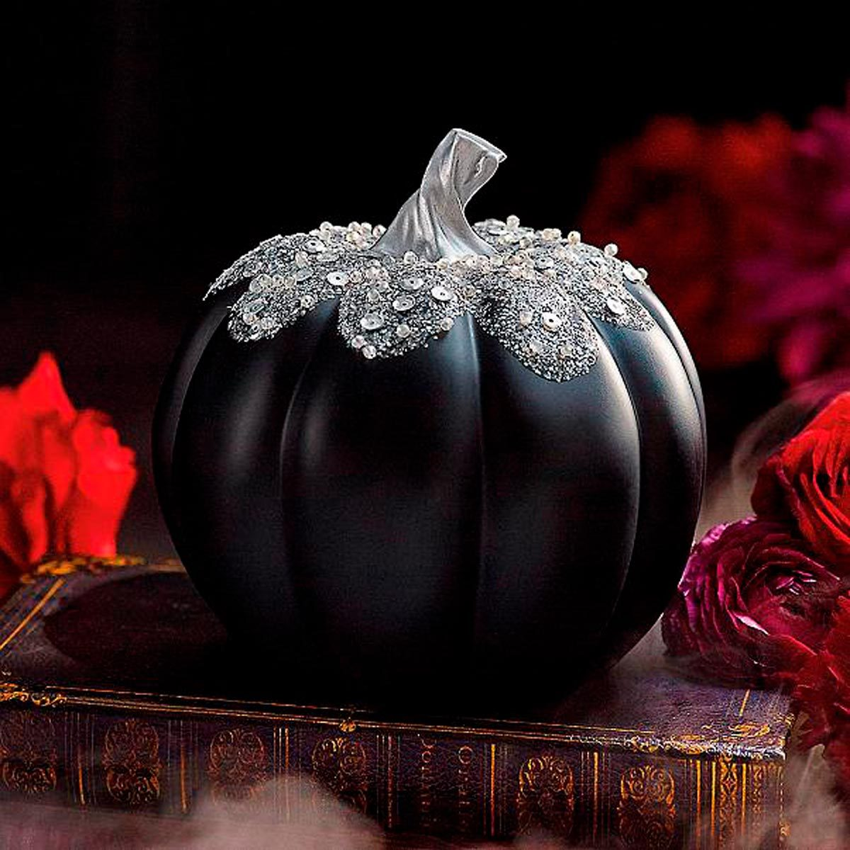 Pumpkin painted all black with silver accent on vine and leafs