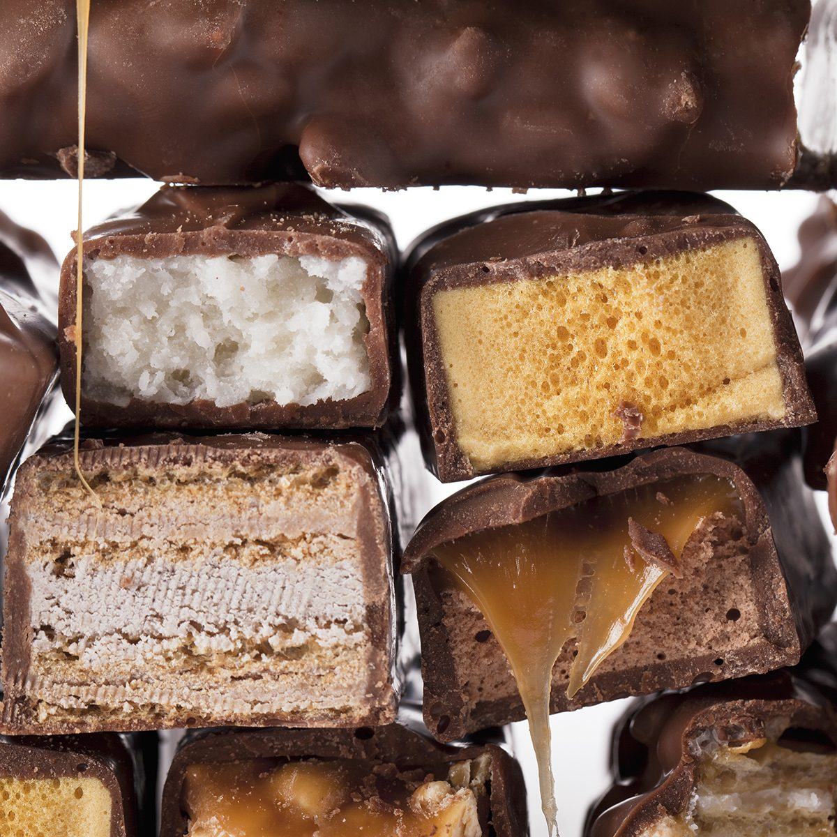Close-up bunch of chocolate bars isolated over the white background