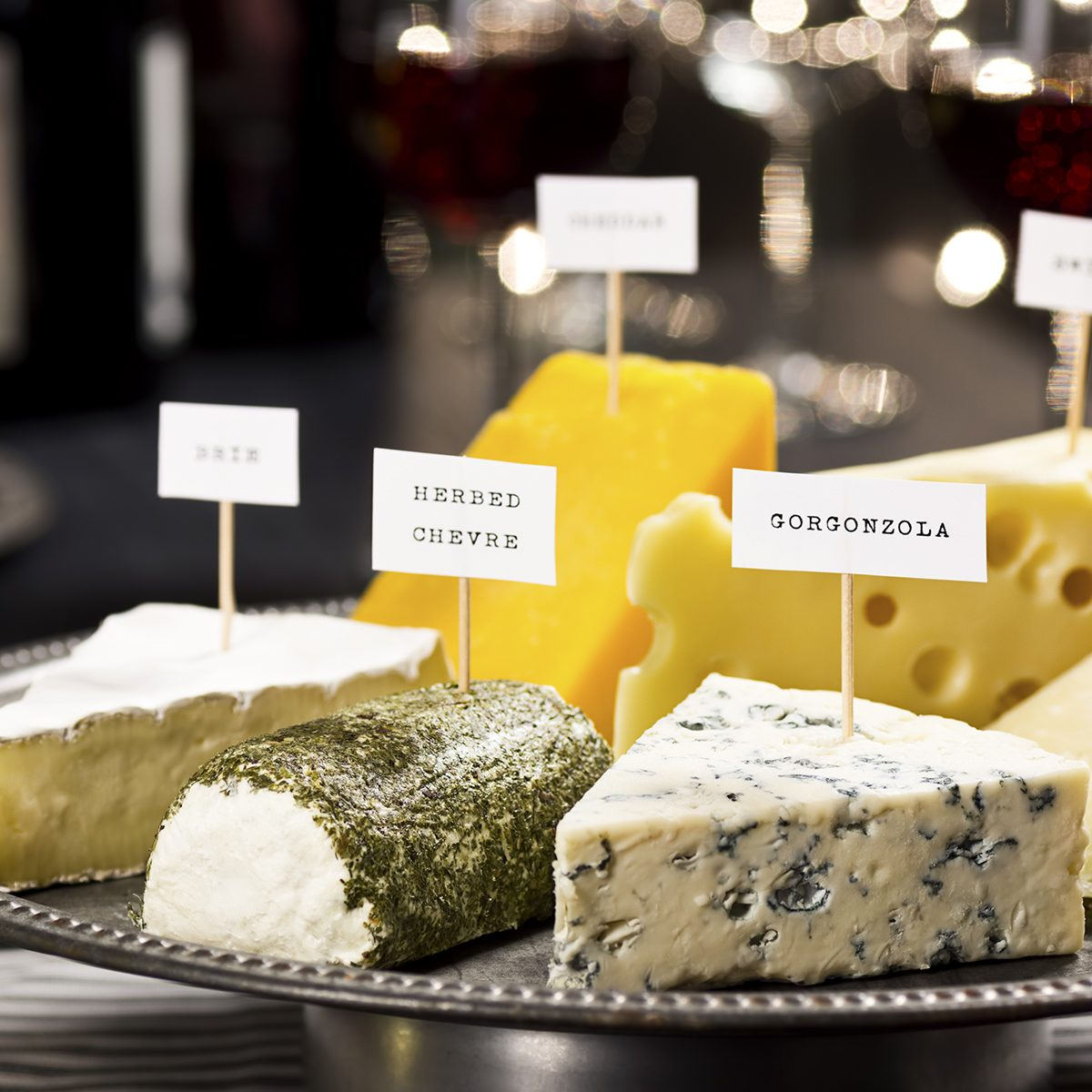 Cheese and Wine Tasting Party with Twinkly Holiday Lights in Background