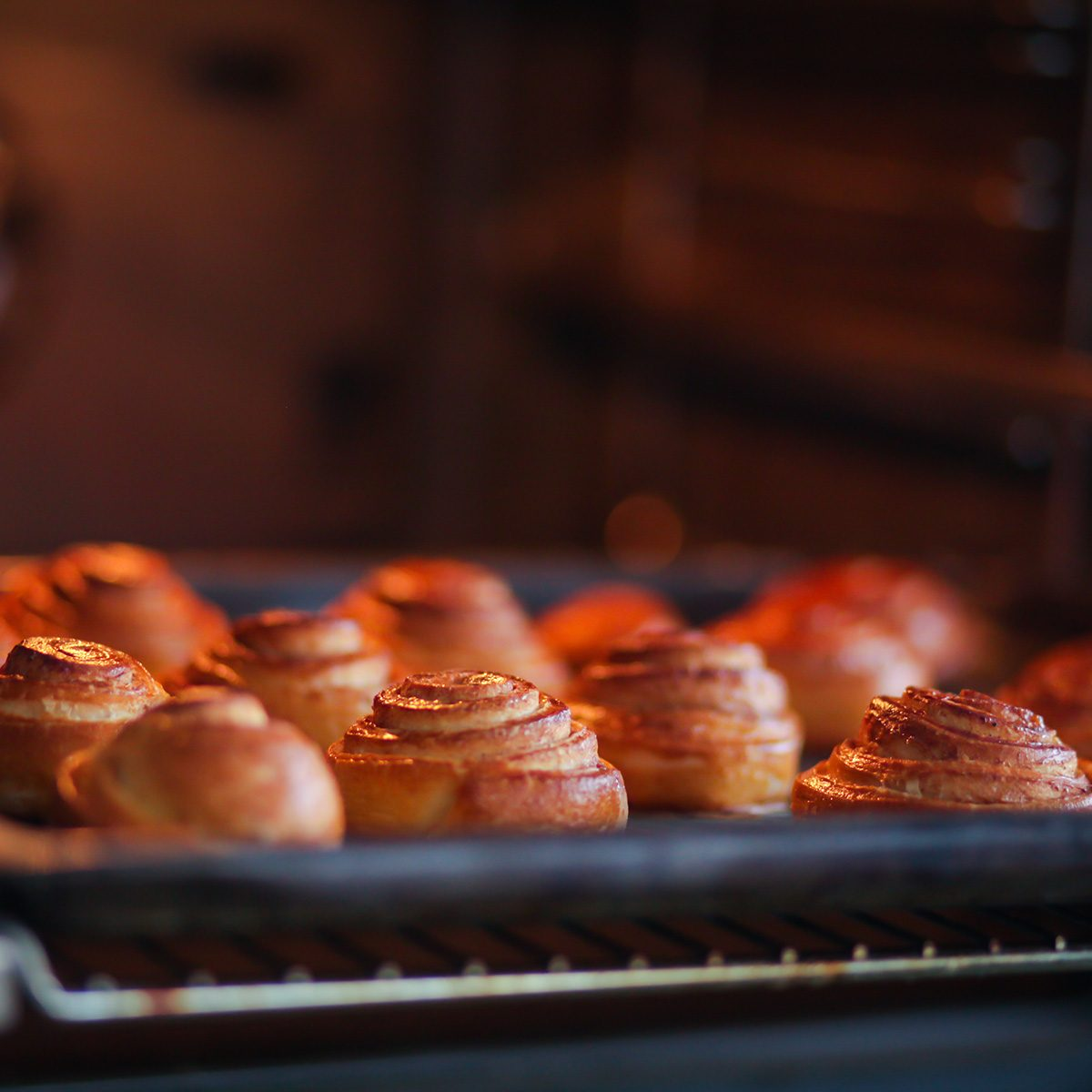 cinnamon rolls are baked in the oven