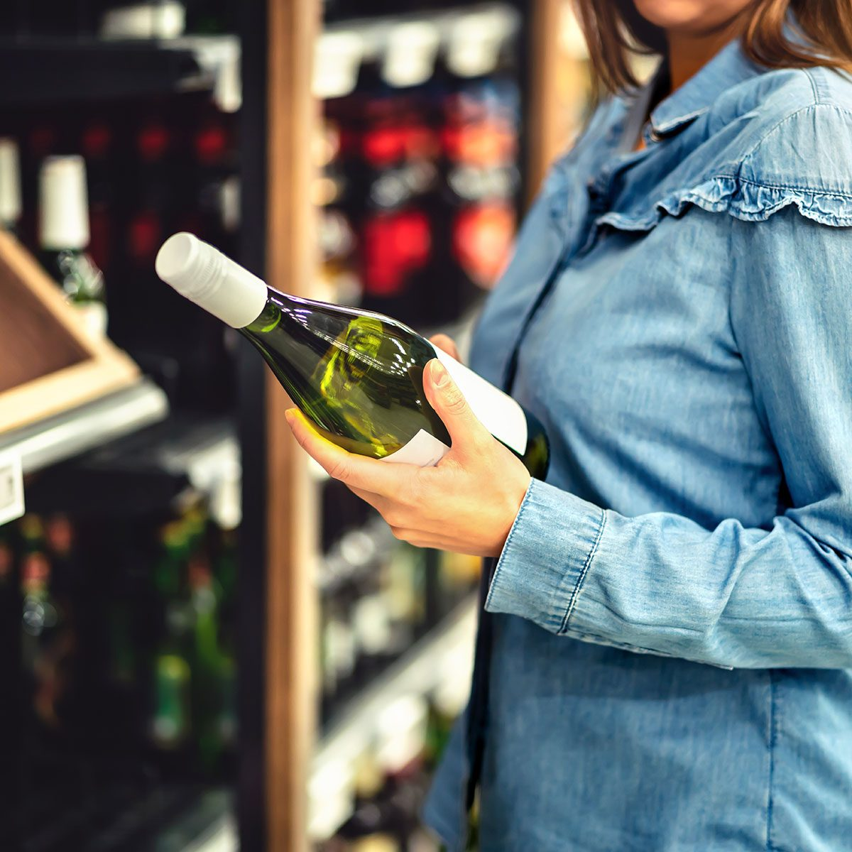 Customer buying white wine or sparkling drink.