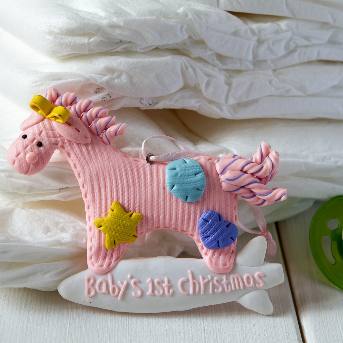 diapers, Christmas toy horse , nipple on a light background