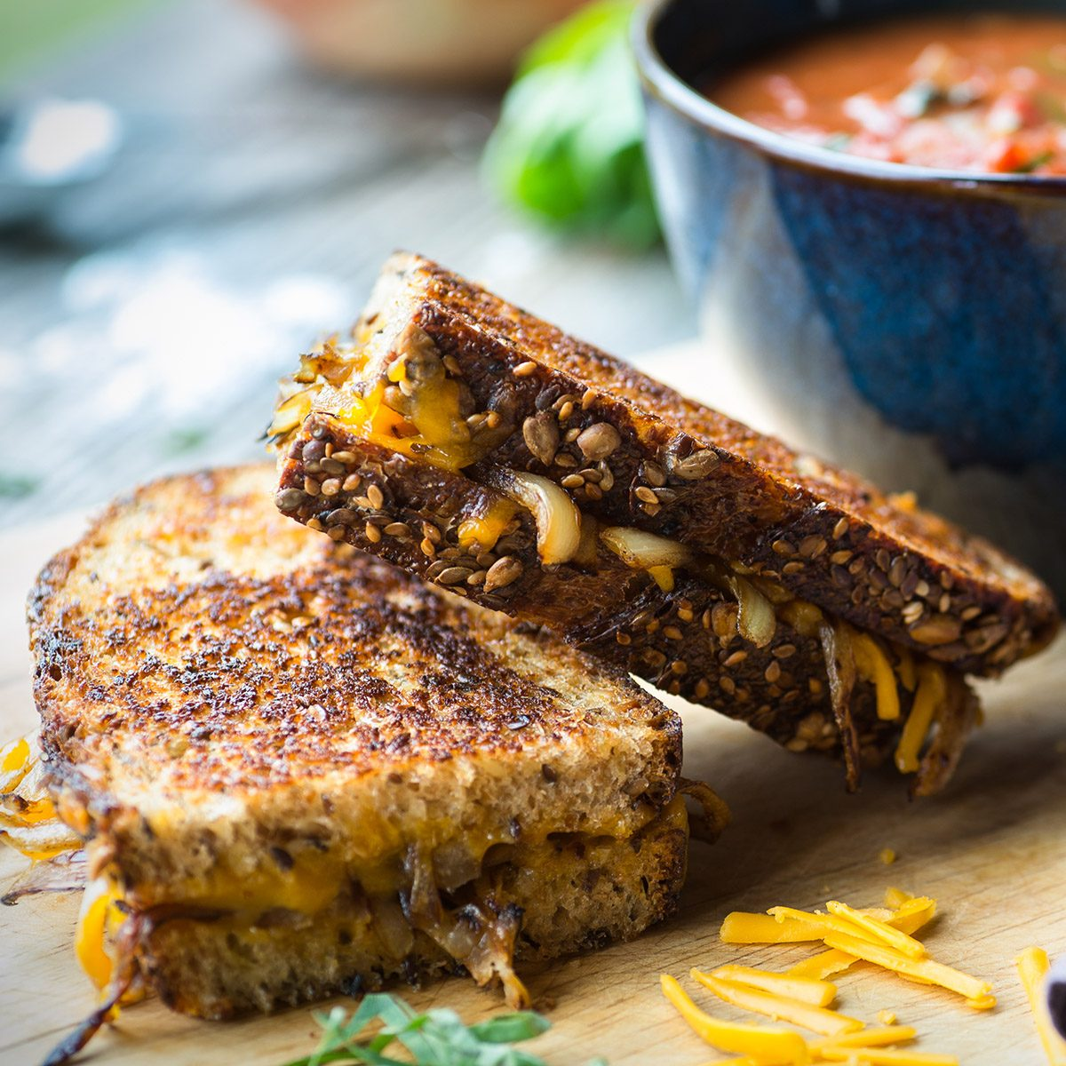 Fresh tomato soup with grilled onion and cheese sandwich