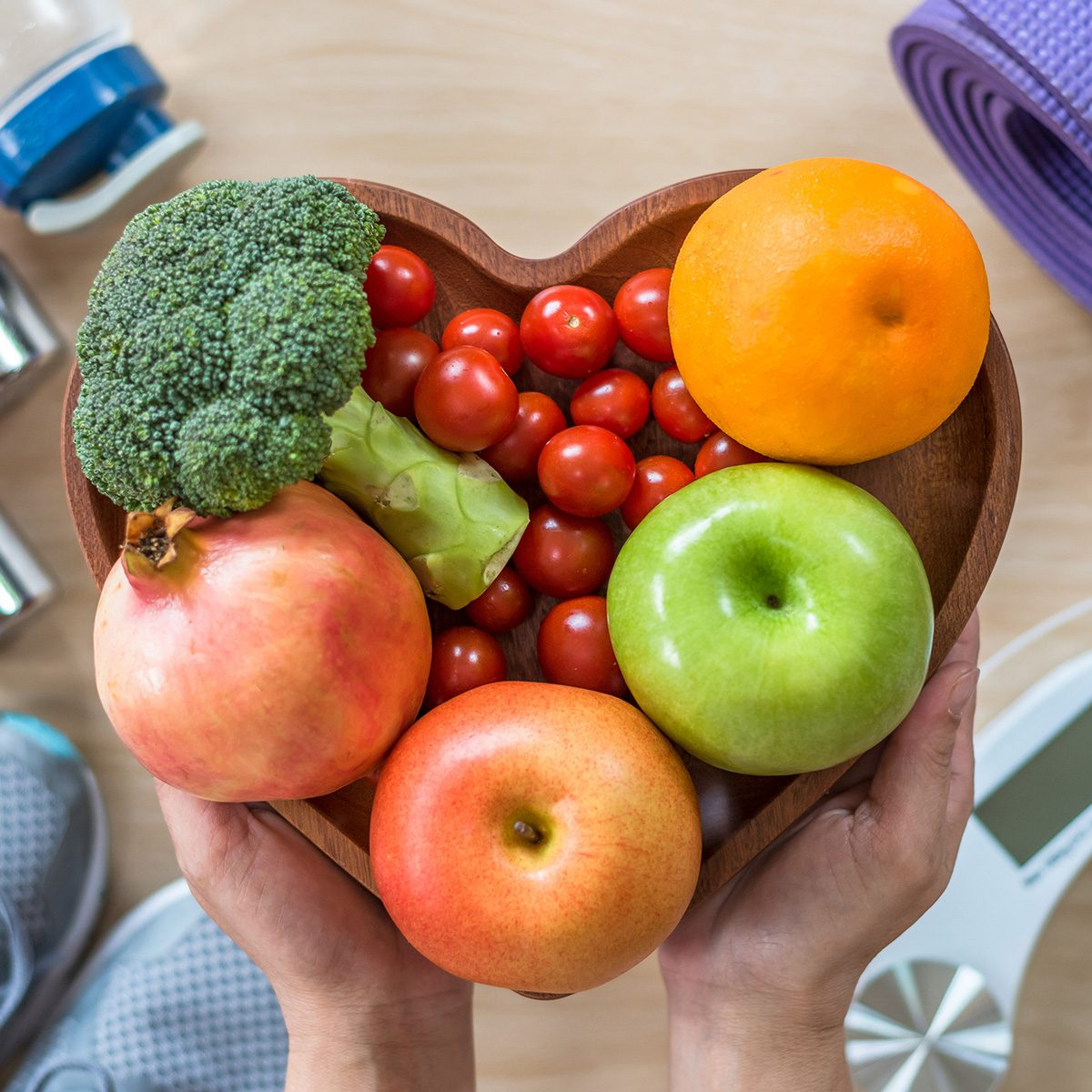Healthy lifestyle concept, eating clean food good health dietary in heart dish with sporty aerobic body exercise workout training class gym equipment, weight scale and sports shoes in fitness center