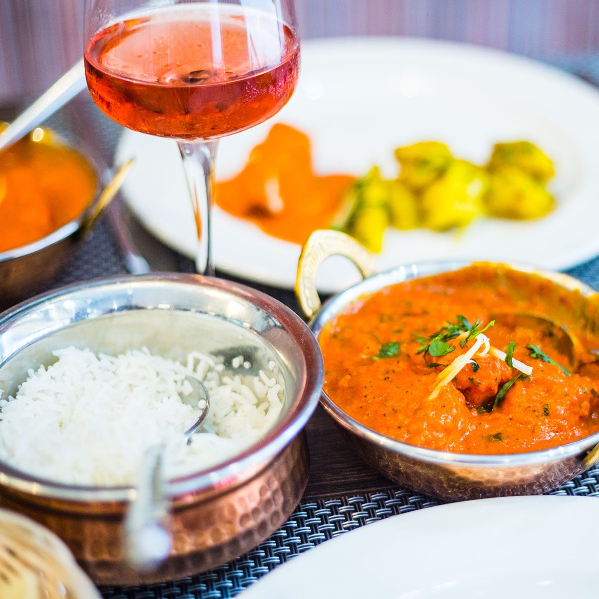 Indian Meal (Rice, Potato in Curry, Chicken Masala) and Wine in Luxury Indian Restaurant