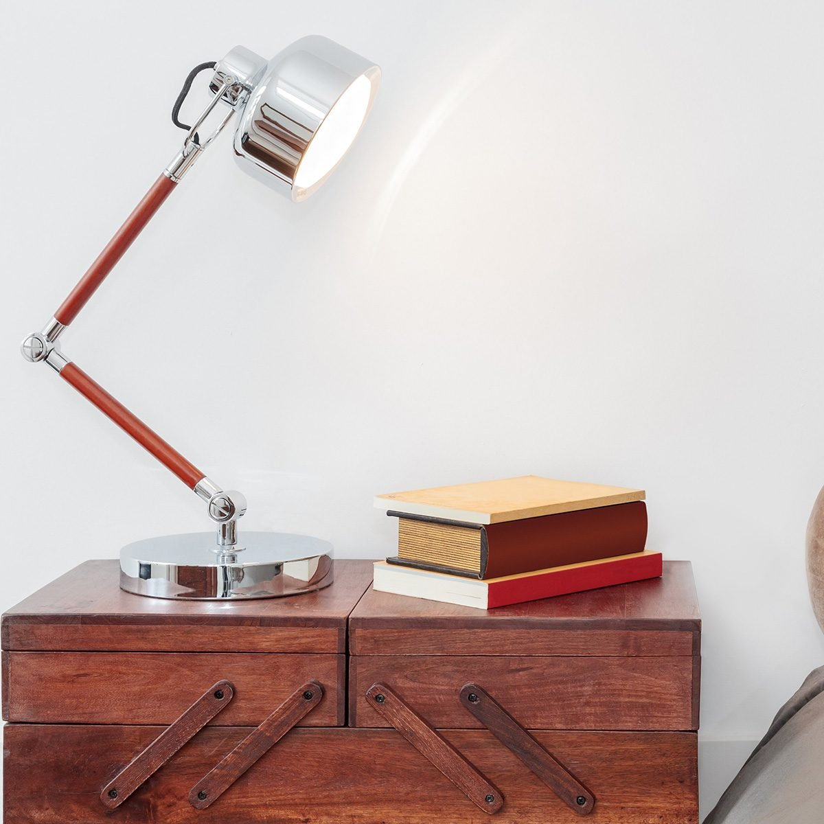 Light and books on a nightstand