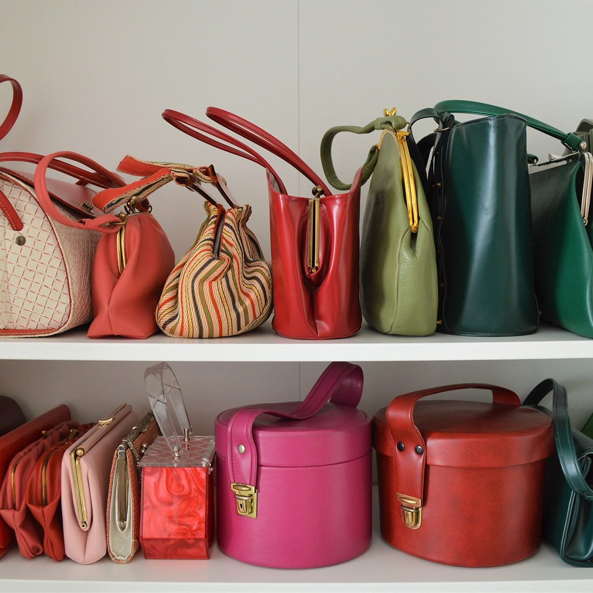 Various purses of all colors on a shelf