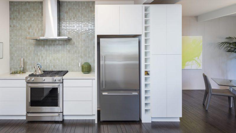 Modern kitchen interior. Design concept with new stainless steel appliances.