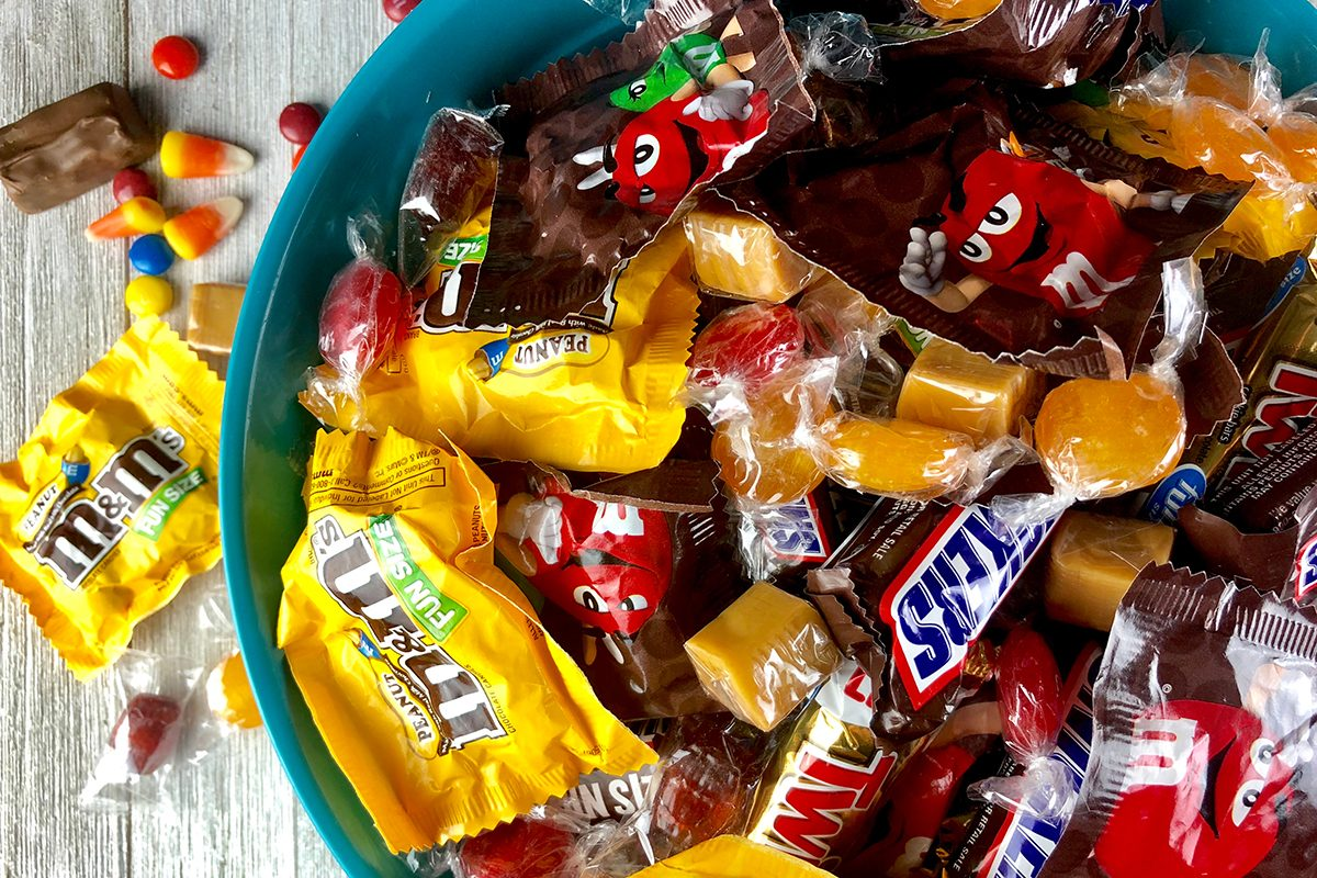 Halloween candy in a plastic bowl; Shutterstock ID 1179593545