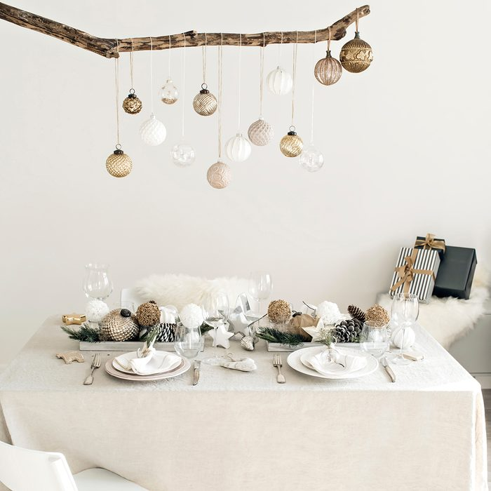 Scene of a bright lit minimalist living room with Christmas decoration and table