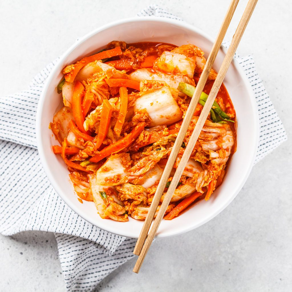 Kimchi cabbage, white background, top view. Korean food, probiotics food.; Shutterstock ID 1315267994; Job (TFH, TOH, RD, BNB, CWM, CM): Taste of Home
