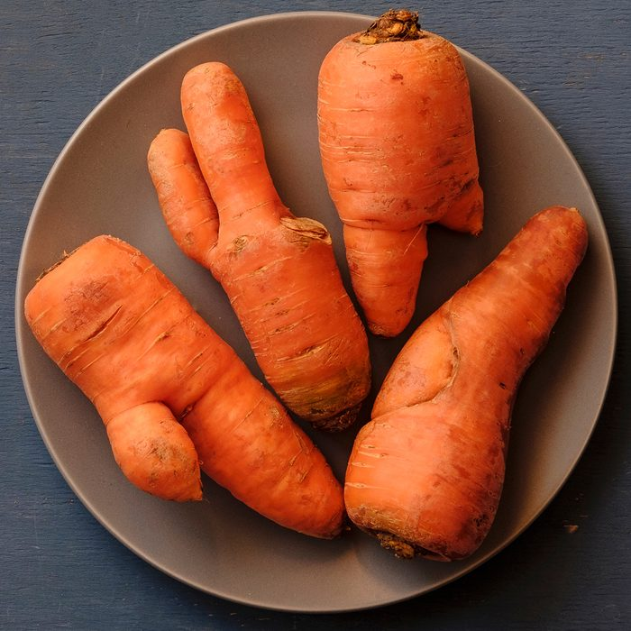Plate with ugly carrots of different unusual imperfect shapes, viewed from above on grey background; Shutterstock ID 1322445116; Job (TFH, TOH, RD, BNB, CWM, CM): TOH