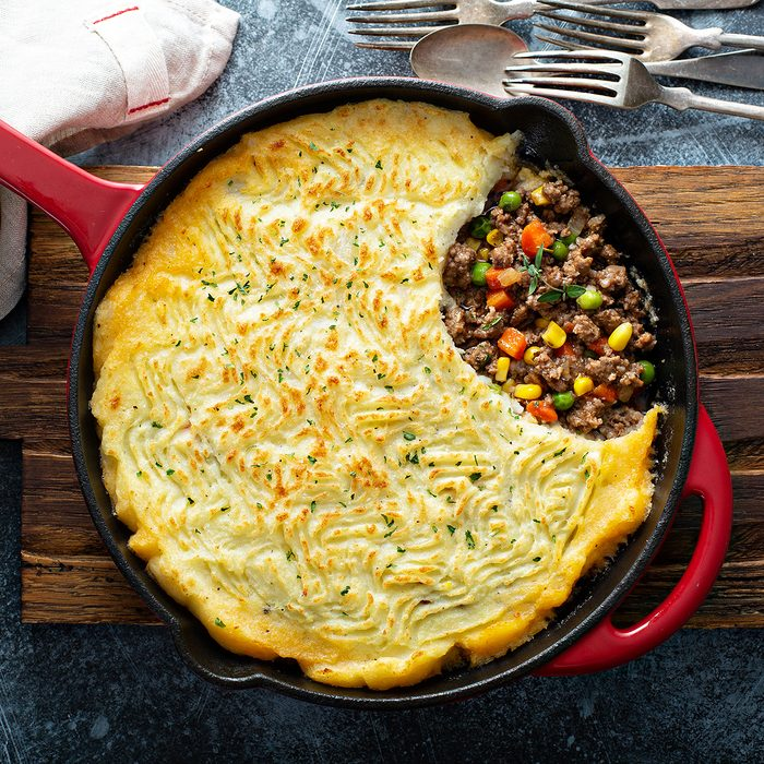 Shepherds pie with ground meat, vegetables and potatoes in a cast iron pan top view; Shutterstock ID 1329534653; Job (TFH, TOH, RD, BNB, CWM, CM): TOH